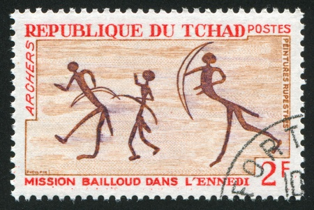 rock painting: CHAD - CIRCA 1968: stamp printed by Chad, shows Rock Painting, Archers, circa 1968