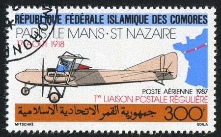 COMORO ISLANDS CIRCA 1987: stamp printed by Comoro Islands, shows Farman biplane, circa 1987 Stock Photo - 11049779