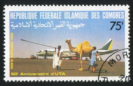 COMORO ISLANDS CIRCA 1985: stamp printed by Comoro Islands, shows Camel driver, circa 1985 photo