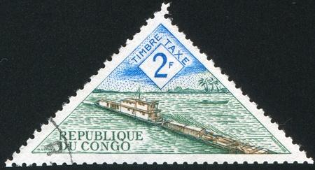 wheelhouse: CONGO CIRCA 1961: stamp printed by Congo, shows River boat transporting barge, circa 1961