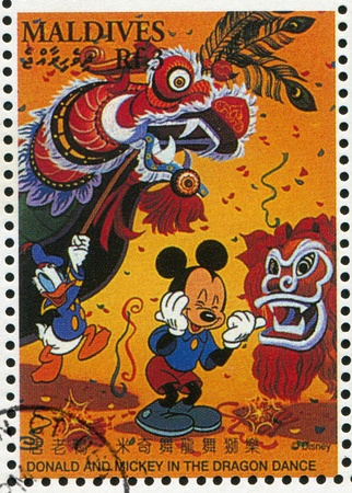 MALDIVE ISLANDS - CIRCA 1996: stamp printed by Maldive Islands, shows Donald, Mickey in dragon dance, circa 1996