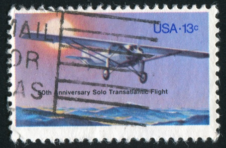 UNITED STATES - CIRCA 1977: stamp printed by United States of America, shows flying plane, circa 1983 Stock Photo - 11082877