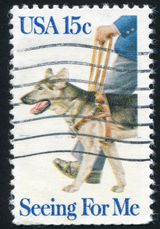 UNITED STATES - CIRCA 1979: stamp printed by United States of America, shows blind man with leading dog, circa 1979 Stock Photo - 11082612