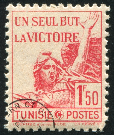 TUNISIA - CIRCA 1943: stamp printed by Tunisia, shows statue Woman with Wings, circa 1943 photo