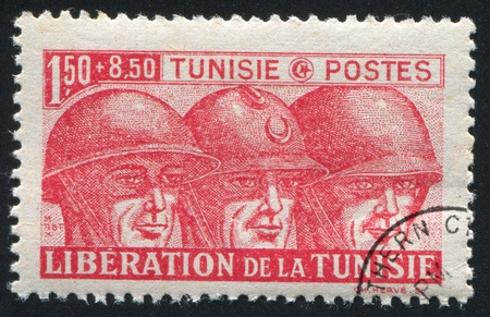 TUNISIA - CIRCA 1943: stamp printed by Tunisia, shows British, French and American Soldiers, circa 1943 Stock Photo - 11130730
