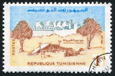 TUNISIA - CIRCA 1960: stamp printed by Tunisia, shows Camel Camp and Mosque, Kairouan, circa 1960 photo