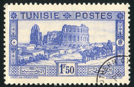TUNISIA - CIRCA 1933: stamp printed by Tunisia, shows Coliseum, circa 1933 photo