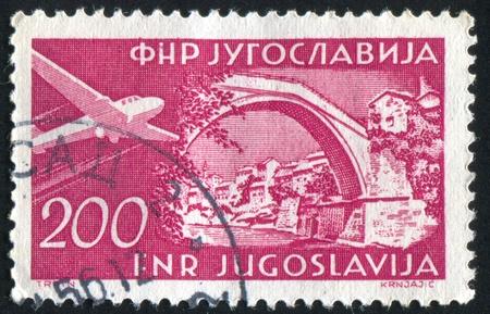 YUGOSLAVIA - CIRCA 1951: stamp printed by Yugoslavia, shows Roman bridge, Mostar, circa 1951 Stock Photo - 11130766