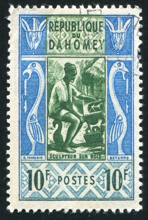 DAHOMEY CIRCA 1961: stamp printed by Dahomey, shows Wood sculptor, circa 1961 photo