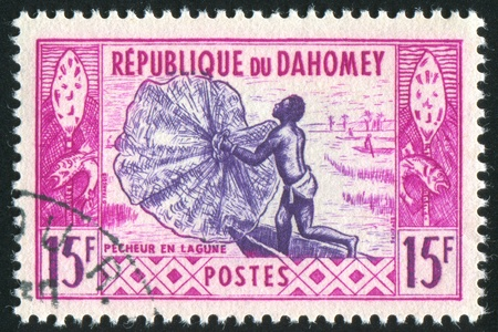 DAHOMEY CIRCA 1961: stamp printed by Dahomey, shows Fisherman and net, circa 1961 photo