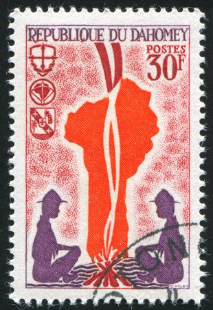 DAHOMEY CIRCA 1966: stamp printed by Dahomey, shows Campfire and map of Dahomey, circa 1966 photo
