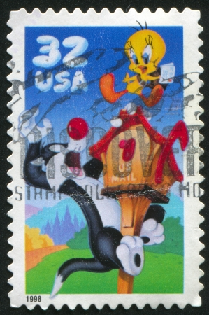 UNITED STATES - CIRCA 1998: stamp printed by United States of America, shows cat catching chicken, circa 1998