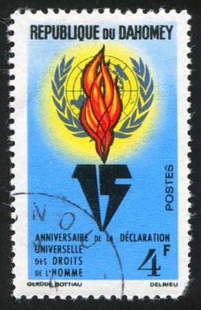 DAHOMEY CIRCA 1963: stamp printed by Dahomey, shows UN Emblem, Flame, circa 1963 photo
