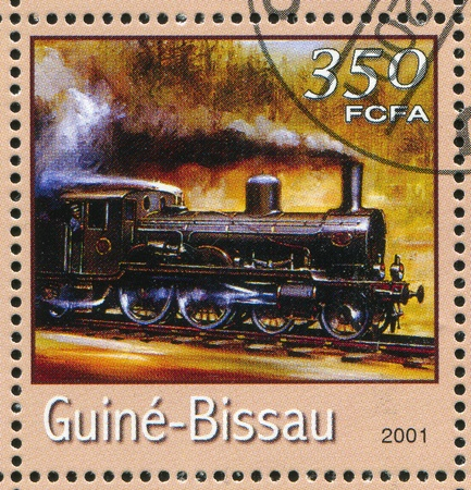 GUINEA-BISSAU - CIRCA 2001: stamp printed by Guinea - Bissau, shows locomotive, circa 2001. photo