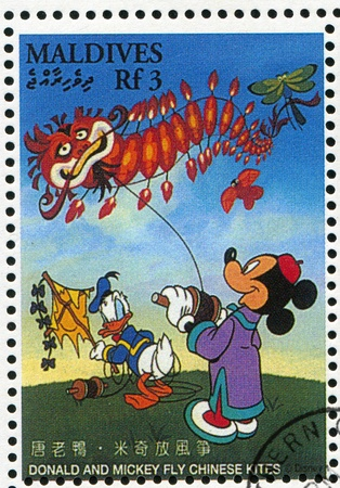 chinese postage stamp: MALDIVE ISLANDS - CIRCA 1996: stamp printed by Maldive Islands, shows Donald, Mickey fly Chinese kites, circa 1996