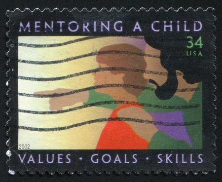 UNITED STATES - CIRCA 2002: stamp printed by United States, shows Child and Father, circa 2002 photo