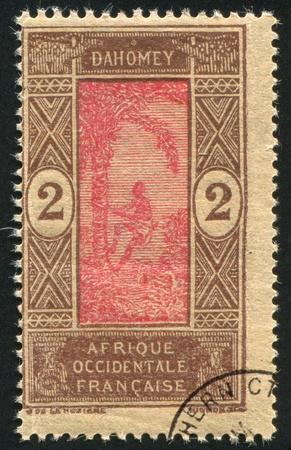 DAHOMEY CIRCA 1922: stamp printed by Dahomey, shows Man Climbing Oil Palm, circa 1922 photo