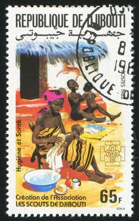 DJIBOUTI CIRCA 1985: stamp printed by Djibouti, shows Hygiene, family health care, circa 1985 Stock Photo - 11220138