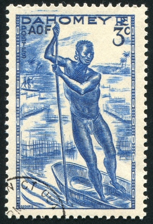 poling: DAHOMEY CIRCA 1941: stamp printed by Dahomey, shows Man Poling a Canoe, circa 1941 Stock Photo
