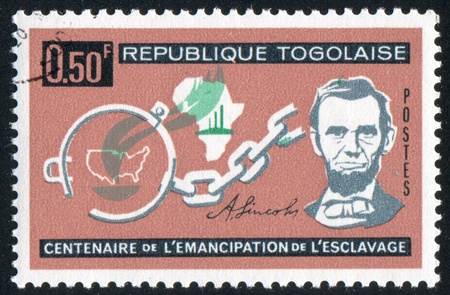 TOGO - CIRCA 1963: stamp printed by Togo, shows Lincoln, Broken Fetters, Maps of Africa and US, circa 1963