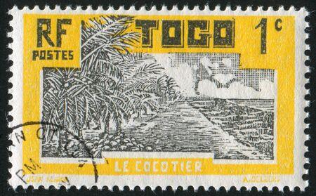 TOGO - CIRCA 1931: stamp printed by Togo, shows Coconut Grove, circa 1931 photo