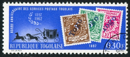 TOGO - CIRCA 1963: stamp printed by Togo, shows Mail Coach and Stamps of 1897, circa 1963 photo