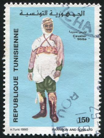 jackboots: TUNISIA - CIRCA 1990: stamp printed by Tunisia, shows Traditional costume Sbiba, circa 1990