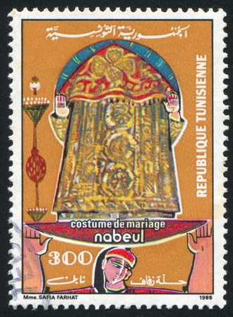 TUNISIA - CIRCA 1986: stamp printed by Tunisia, shows Regional bridal costume, Nabeul, circa 1986 Stock Photo - 11264666