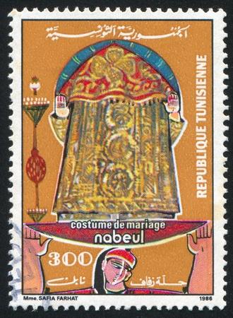 TUNISIA - CIRCA 1986: stamp printed by Tunisia, shows Regional bridal costume, Nabeul, circa 1986 Stock Photo - 11264666