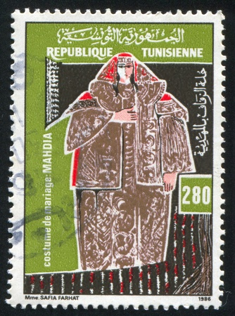 TUNISIA - CIRCA 1986: stamp printed by Tunisia, shows Regional bridal costume, Mahdia, circa 1986 Stock Photo - 11264611
