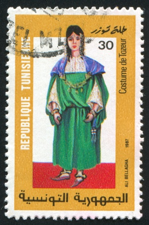 TUNISIA - CIRCA 1987: stamp printed by Tunisia, shows Folk Costume, Tozeur, circa 1987 Stock Photo - 11264543