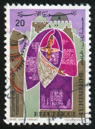 matmata: TUNISIA - CIRCA 1985: stamp printed by Tunisia, shows Regional bridal costume, Matmata, circa 1985 Stock Photo