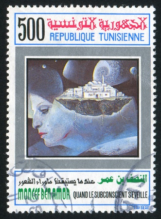 TUNISIA - CIRCA 1992: stamp printed by Tunisia, shows When the Subconscious Awakes by Moncef ben Amor, circa 1992 photo