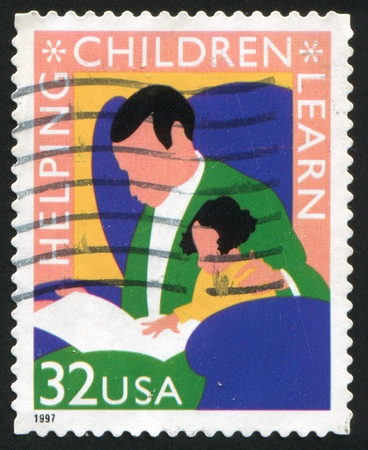 UNITED STATES - CIRCA 1997: stamp printed by United States of America, shows reading man and child, circa 1997 Stock Photo - 11261235