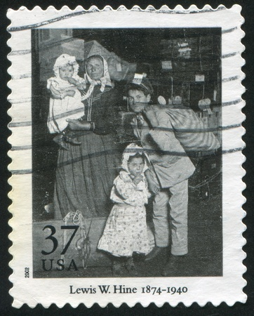 "UNITED STATES - CIRCA 2002: stamp printed by United States of America, shows ""Looking for Lost Luggage, Ellis Island"" by Lewis W. Hine, circa 2002"