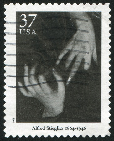 UNITED STATES - CIRCA 2002: stamp printed by United States of America, shows Hands and Thimble by Alfred Stieglitz, circa 2002 photo