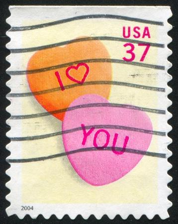 fidelidad: ESTADOS UNIDOS - CIRCA 2004: sello impreso por Estados Unidos de América, muestra los corazones de caramelo, alrededor del año 2004