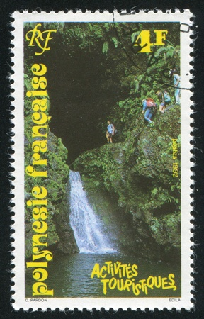 FRENCH POLYNESIA CIRCA 1992: stamp printed by French Polynesia, shows Waterfalls, circa 1992 photo