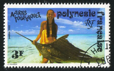FRENCH POLYNESIA CIRCA 1992: stamp printed by French Polynesia, shows Girl holding fish, circa 1992