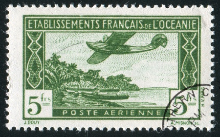 FRENCH POLYNESIA CIRCA 1934: stamp printed by French Polynesia, shows Seaplane in Flight, circa 1934 Stock Photo - 11339260