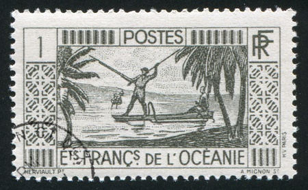 FRENCH POLYNESIA CIRCA 1934: stamp printed by French Polynesia, shows Spear Fishing, circa 1934 Stock Photo - 11339245