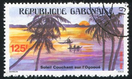 GABON CIRCA 1984: stamp printed by Gabon, shows Canoes, Ogooue River, circa 1984 Stock Photo - 11339528