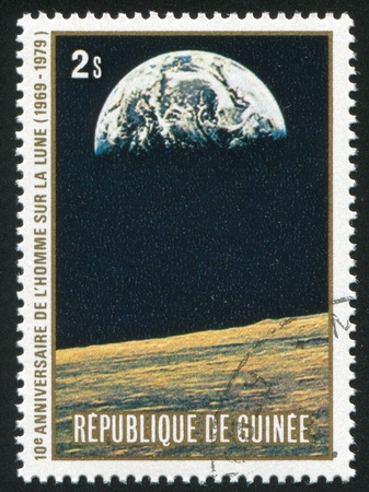 GUINEA CIRCA 1980: stamp printed by Guinea, shows Earth from moon, circa 1980 photo