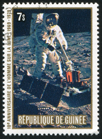 GUINEA CIRCA 1980: stamp printed by Guinea, shows Collecting samples, circa 1980 photo
