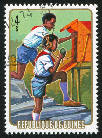 GUINEA CIRCA 1974: stamp printed by Guinea, shows Communication, circa 1974 photo