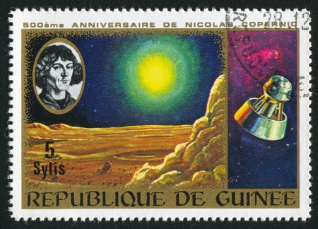 copernicus: GUINEA CIRCA 1973: stamp printed by Guinea, shows Copernicus, Moon landscape and spacecraft, circa 1973