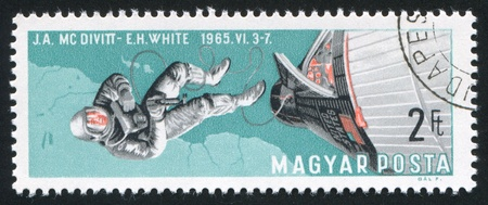 HUNGARY - CIRCA 1966: stamp printed by Hungary, shows Edward White walking in space, circa 1966 photo