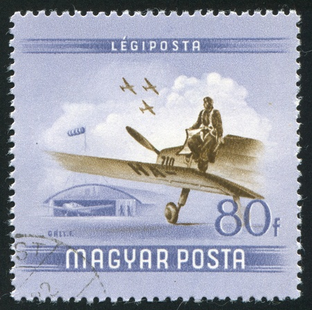 HUNGARY - CIRCA 1954: stamp printed by Hungary, shows Pilot leaving plane, circa 1954 photo