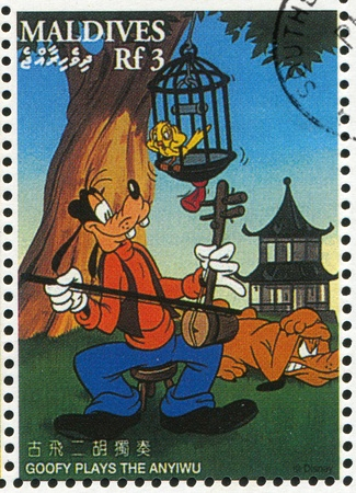 MALDIVE ISLANDS - CIRCA 1996: stamp printed by Maldive Islands, shows Goofy plays anyiwu, circa 1996