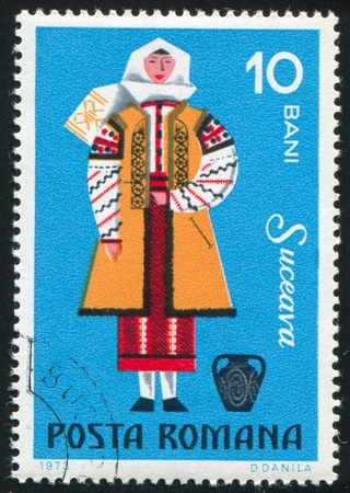 ROMANIA - CIRCA 1973: stamp printed by Romania, shows Suceava woman, circa 1973 Stock Photo - 11339414